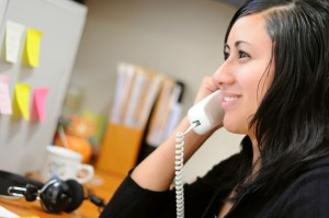 Woman learning the qualities of effective communication on the phone with client
