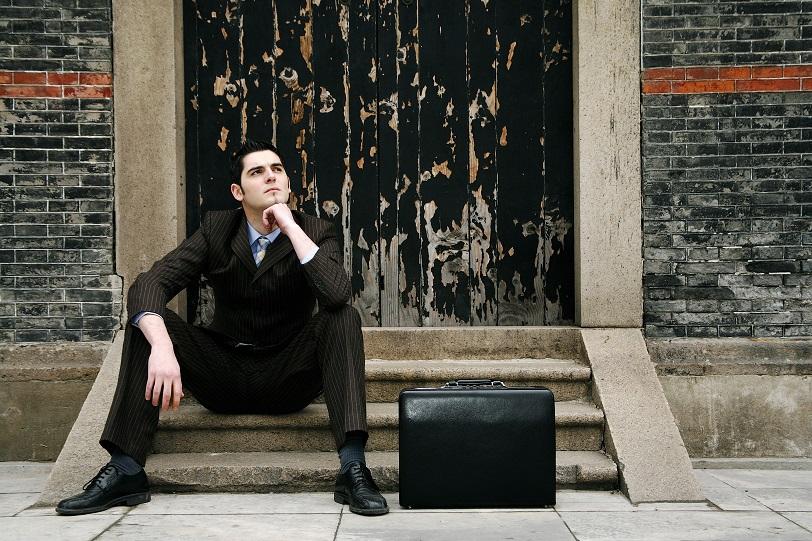 sitting helpless man
