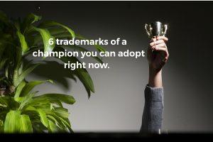 Champion   man holding trophy